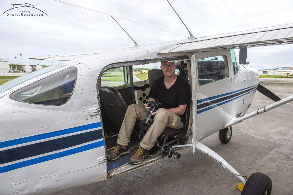 Daniel Rosengren (FZS photographer) getting ready for a flight over Kaieteur NP to look for and map illegal gold mining activities. The door has been removed to better be able to take photos. Eugene F. Correia International Airport, Georgetown, Guyana. © Daniel Rosengren